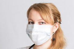 Beautiful woman doctor  in a protective mask Stock Photo