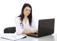 Beautiful woman doctor working on a laptop and smiling Stock Image