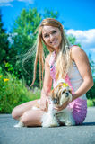 Beautiful woman with dog leash Stock Photography