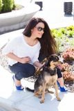 Beautiful woman with dog Royalty Free Stock Image