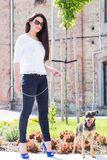 Beautiful woman with dog Stock Photography