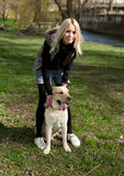 Beautiful woman with dog in the park Royalty Free Stock Images