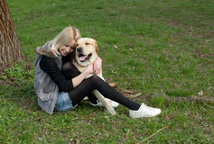 Beautiful woman with dog in the park Stock Photo