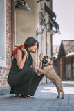 Beautiful woman with dog on the street Stock Images