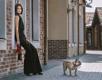 Beautiful woman with dog on the street Royalty Free Stock Images