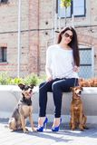 Beautiful woman with dogs Stock Images