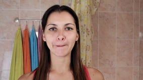 Beautiful woman doing anti-aging exercises. Gymnastics for a face. Facebuilding facial exercises. Face yoga. girl stock footage
