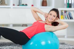 Beautiful woman doing exercice at home. Female Stock Image