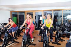 Beautiful woman doing exercise in a spinning class Stock Photo