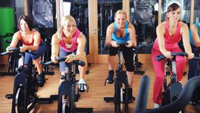 Beautiful woman doing exercise in a spinning class Royalty Free Stock Photo