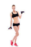 Beautiful woman doing exercises with dumbells Royalty Free Stock Images