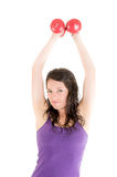 Beautiful woman doing exercises with dumbells Stock Photo