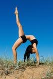 Beautiful woman  doing exercises  outdoor. Stock Photography