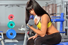 Beautiful woman doing exercises in a sport club. Stock Photography