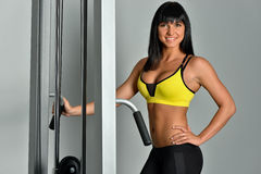 Beautiful woman doing exercises in a sport club. Royalty Free Stock Image