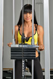 Beautiful woman doing exercises in sport club. Royalty Free Stock Images