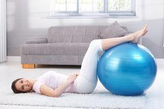 Beautiful woman doing fit ball exercise smiling Royalty Free Stock Photo
