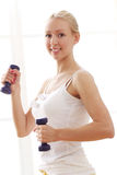 Beautiful woman doing fitness exercises Royalty Free Stock Photos