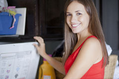 Beautiful woman doing laundry Royalty Free Stock Image