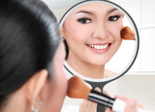 Beautiful woman doing make up Royalty Free Stock Images