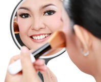 Beautiful woman doing make up Stock Photo