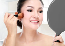 Beautiful woman doing make up Stock Photos