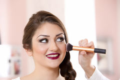 Beautiful woman doing make-up on face Royalty Free Stock Photo