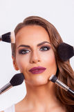 Beautiful woman doing make-up on face Stock Photos