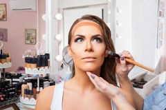 Beautiful woman doing make-up on face Royalty Free Stock Image
