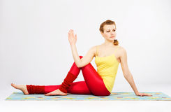Beautiful woman doing marichi's yoga pose Stock Photos