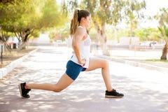 Beautiful woman doing morning workout stock photography
