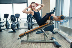 Beautiful woman doing press fitness exercise at Stock Image