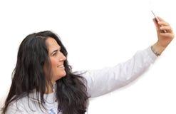 Beautiful woman is doing selfie Stock Image
