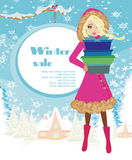 Beautiful woman doing the shopping in winter Stock Photography