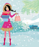 Beautiful woman doing the shopping in winter Stock Image