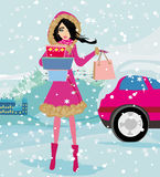 Beautiful woman doing the shopping in winter Stock Images