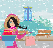 Beautiful woman doing the shopping in winter Stock Photos