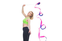 Beautiful woman doing sport exercise with gymnastic ribbon Stock Photo