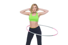Beautiful woman doing sport exercise with hula hoop Stock Images