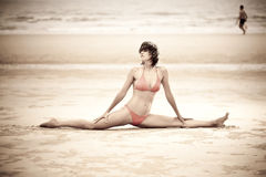Beautiful woman doing stretches exercise Stock Photo