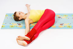 Beautiful woman doing stretching exercise Royalty Free Stock Photos