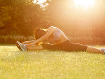 Beautiful Woman doing Stretching Exercise against Nature Backgro Royalty Free Stock Photo