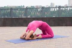 Beautiful woman doing Vriksasana pose on yoga class stock photos