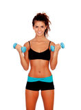 Beautiful woman doing weights to tone her muscles Royalty Free Stock Photography