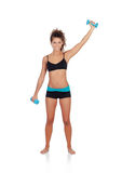 Beautiful woman doing weights to tone her muscles Royalty Free Stock Image