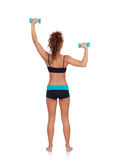 Beautiful woman doing weights to tone her muscles. Isolated on a white background royalty free stock image