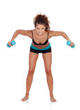 Beautiful woman doing weights to tone her muscles. Isolated on a white background stock photography