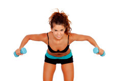Beautiful woman doing weights to tone her muscles. Isolated on a white background stock photo