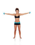 Beautiful woman doing weights to tone her muscles Stock Photo