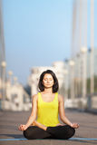 Beautiful woman doing yoga on the background of the urban landsc Royalty Free Stock Photography